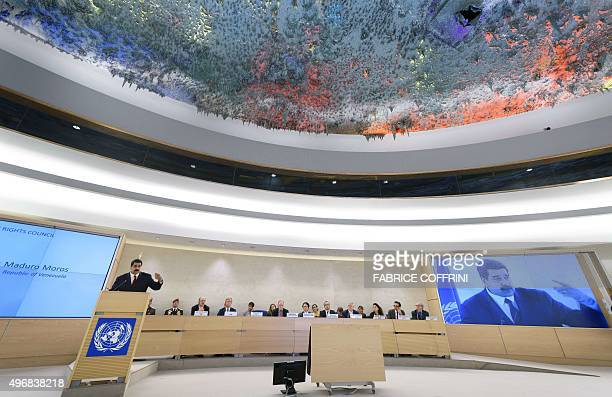 Part of the ceiling painted by Spanish abstract artist Miquel Barcelo is seen as Venezuela's President Nicolas Maduro addresses the UN human rights...