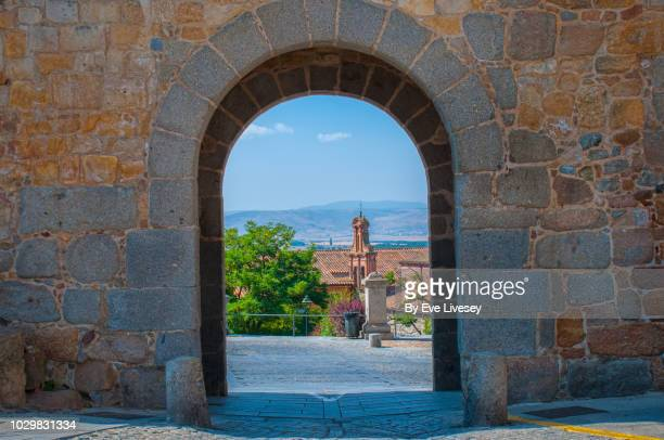 part of the city walls and the saint's gate (puerta de la santa) - avila stock photos and pictures