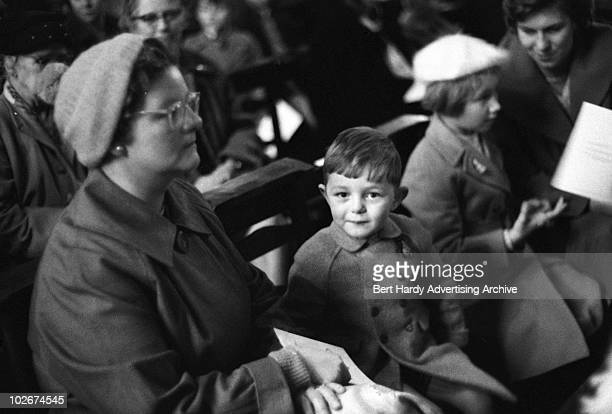 Part of the congregation at a Christmas carol service 19th December 1959