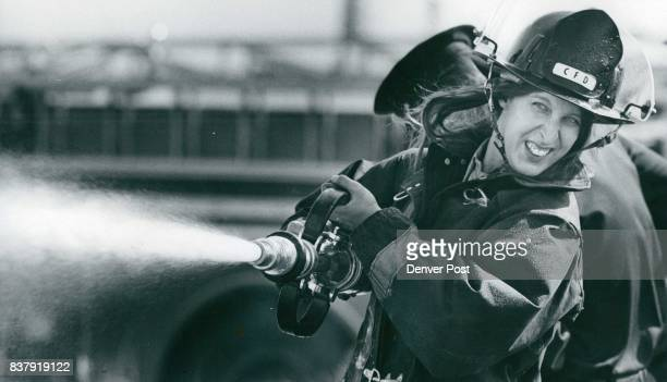 Part of the day's training consisted of practicing with ***** pressure hose with she drenched TV newsman Credit Denver Post