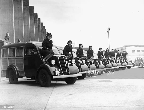 Part of the fleet of vans with their drivers who will be transporting competitors between the various centres and sporting events at the 1948 London...