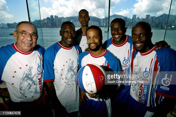 Part of The Harlem Globetrotters basketball team members pose for picture with the backdrop of Hong Kong including lr Charles Harrisson Mathew...