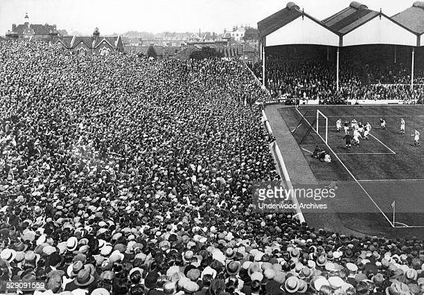 Part of the huge crowd at Arsenal Stadium in Highbury to witness the first game of the football season between Arsenal and Birmingham London England...