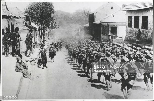 Part of the immense enemy forces which have recaptured Lemberg German Infantry in a Galician village The fall of Lemberg as is well known was due to...