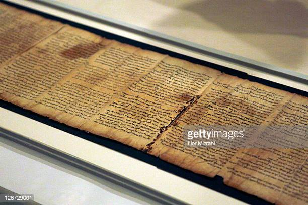 A part of the Isaiah Scroll one of the Dead Sea Scrolls is seen inside the vault of the Shrine of the Book building at the Israel Museum on September...