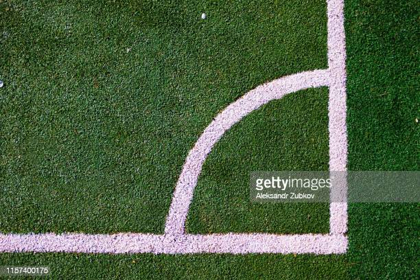 part of the layout of the football field, the position of the corner kick. white marking lines on the green grass of the sports stadium. - taking a corner stock pictures, royalty-free photos & images