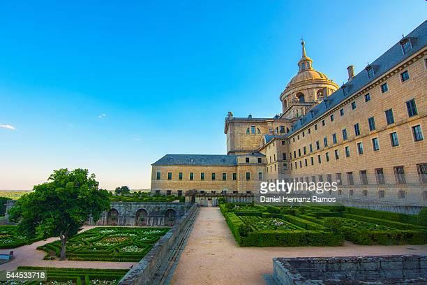 A part of the Monasterio de El Escorial, with an ornamental garden, Madrid. Spain