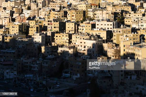 Part of the Old Town of Amman in the shade during the sunset, seen from the Citadel historical site. On Saturday, February 2 in Amman, Jordan.