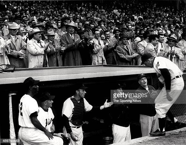 Part of the opening crowd of 50230 shows its approval to Ralph Kiner of the Cleveland Indians as he enters the dugout after he hit a 5th inning homer...