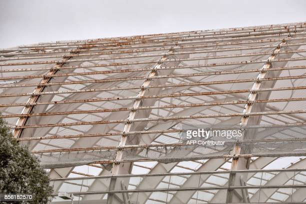 A part of the roof of the Stade de la Licorne in Amiens northern France is pictured on October 1 a day after the French L1 football match Amiens SC v...
