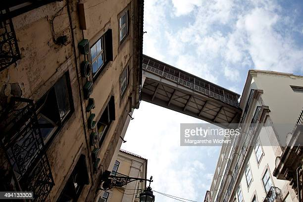 A part of the Santa Justa Lift is seen between two buildings on September 16 2011 in Lisbon Portugal