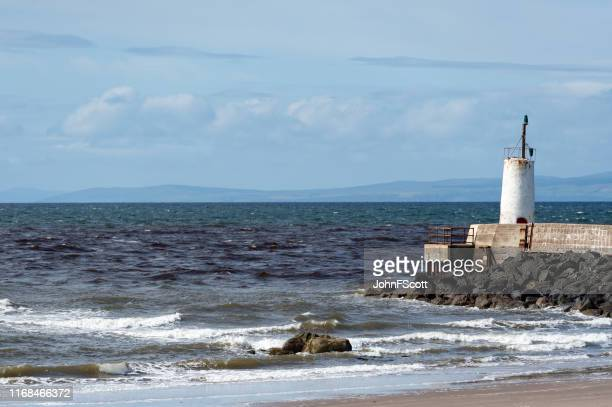 part of the sea wall at girvan harbour on a bright sunny day - johnfscott stock pictures, royalty-free photos & images