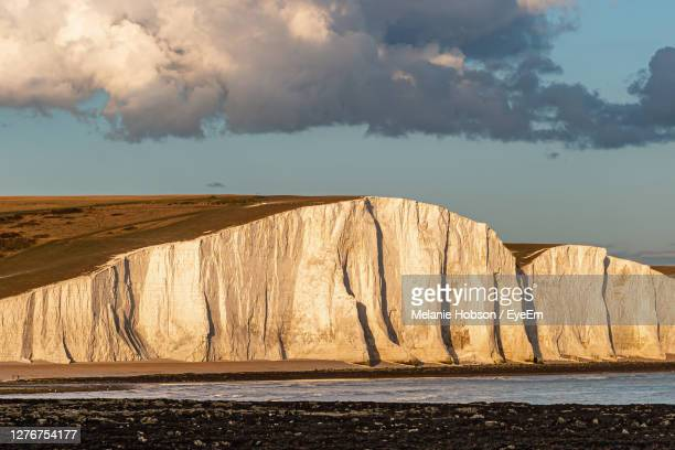 part of the seven sisters cliffs in sussex, on a summers evening - chalk rock stock pictures, royalty-free photos & images