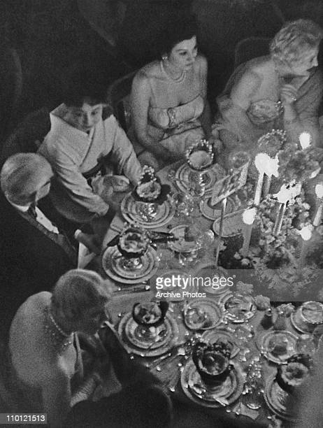 Part of the Skouras party dining at the Knickerbocker Ball at the Waldorf Hotel, New York City, 1959.