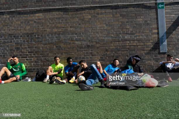 """Part of the team F.C Darna resting after training at the """" La Catalana """" soccer field in the central Barceloneta neighborhood on March 13, 2021 in..."""
