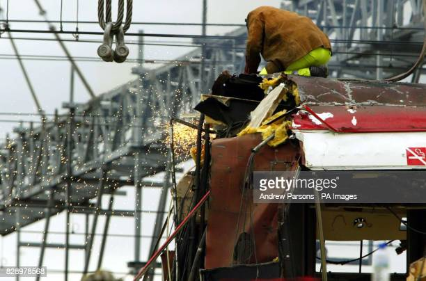 Part of the train attacked by a bomb blast in Madrid is moved off the track near Atocha station.