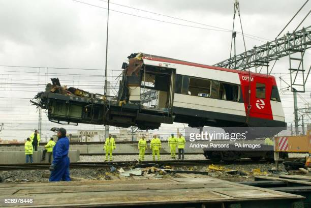 Part of the train hit attacked by a bomb blast in Madrid is moved off the track near Atocha station
