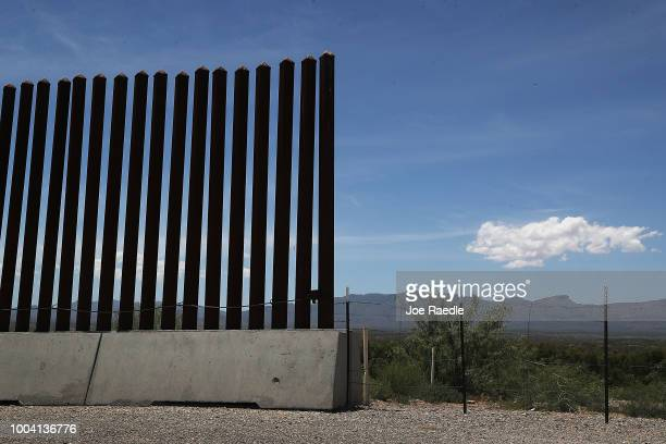 Part of the US/Mexico border fence is seen on July 22 2018 near Presidio Texas A courtordered July 26th deadline is approaching for the US government...