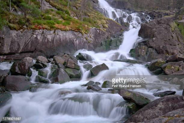 part of the waterfall langfossen in åkrafjord norway - finn bjurvoll stock pictures, royalty-free photos & images