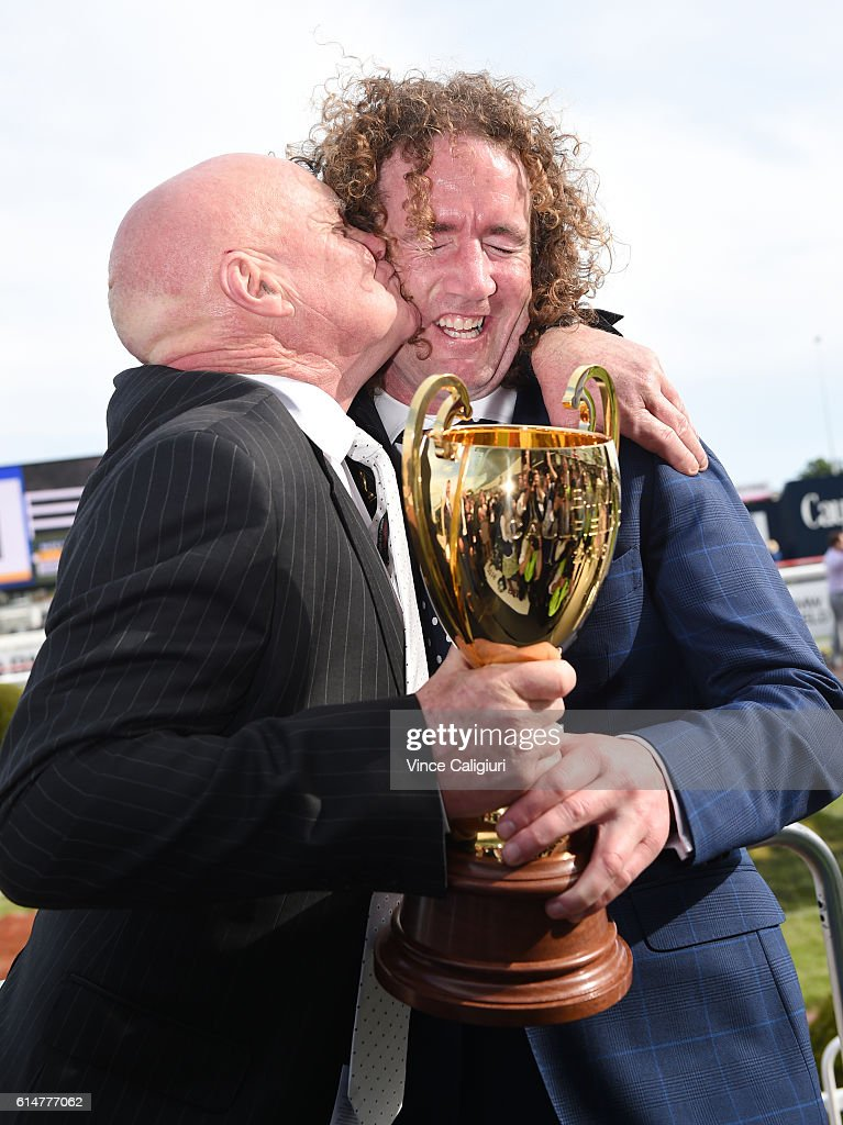 Part owner Colin McKenna kisses trainer Ciaron Maher after Jameka won Race 8, BMW Caulfield Cup during Caulfield Cup Day at Caulfield Racecourse on October 15, 2016 in Melbourne, Australia.
