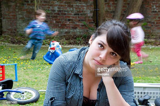 a part time nanny struggling to cope - family with two children stock photos and pictures