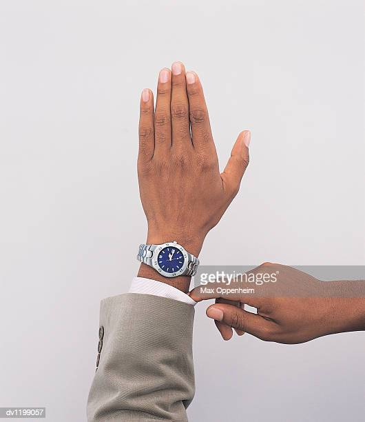Part View of a Businessman Checking the Time on His Wristwatch