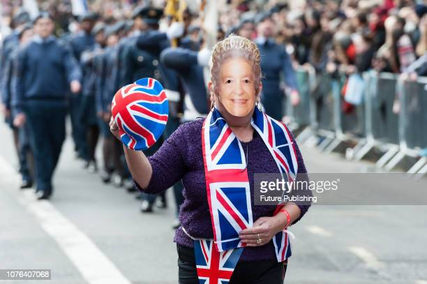 Partcipant wearing a mask of Queen Elizabeth II during London's New Year's Day Parade 2019 Around 500000 spectators gather along the parade route to...