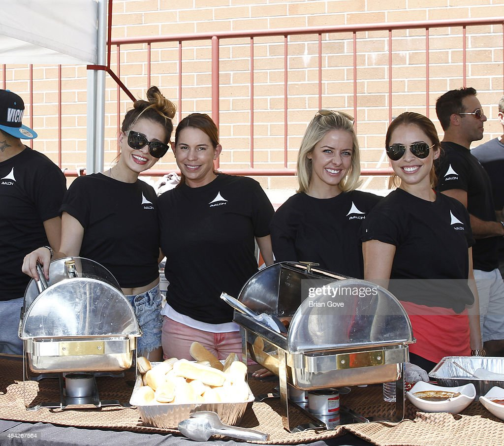 partcipants gather to help serve food at the Hollywood Chamber Of Commerce Annual Police And Fire BBQ on August 27, 2014 in Hollywood, California.