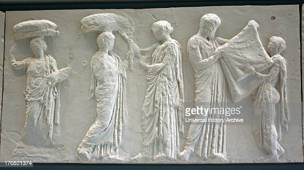 A young winged goddess Iris or Hebe messenger of the diving couple Zeus and Hera stands next to Hera turning toward the procession while she arranges...