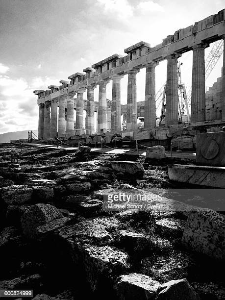 Parthenon On Rocky Field Against Sky