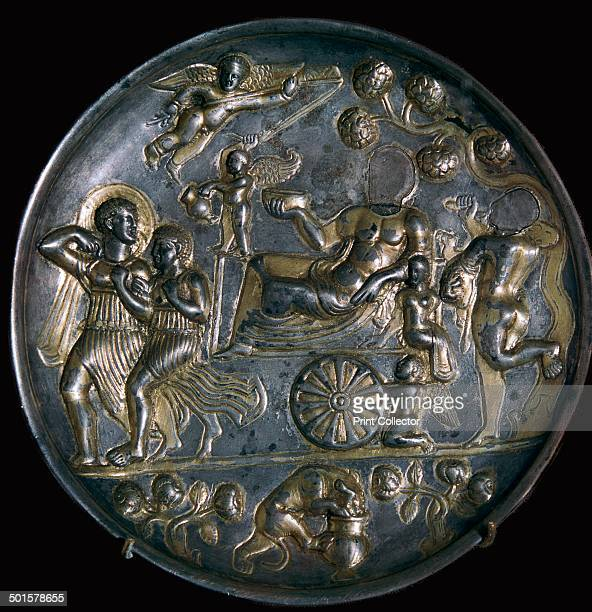 Parthian silver dish showing Dionysus on a chariot with Ariadne the very small female figure The dish has Hellenistic influences but is in Bactrian...
