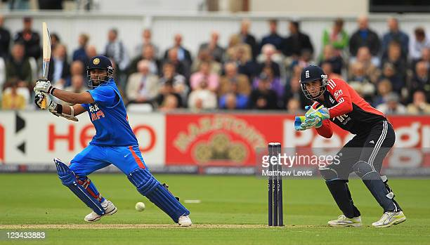 Parthiv Patel of India hits the ball towards the boundary as Craig Kieswetter of England looks on during the 1st NatWest One day International Series...