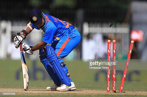 Parthiv Patel of India is bowled by Kemar Roach of the West Indies during the 5th One Day International between India and West Indies at the TNCA MA...