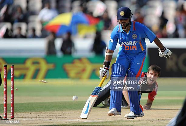 Parthiv Patel of India is run out by Steven Finn of England during the 1st One Day International between England and India at The Rajiv Gandhi...