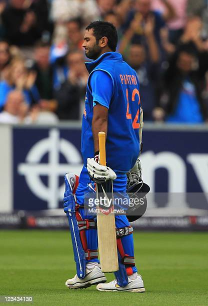 Parthiv Patel of India walks off after he was caught by Craig Kieswetter of England off the bowling of James Anderson during the 1st NatWest One day...