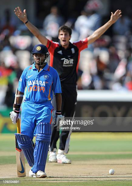 Parthiv Patel of India walks off as Steven Finn of England celebrates running him out during the 1st One Day International between England and India...