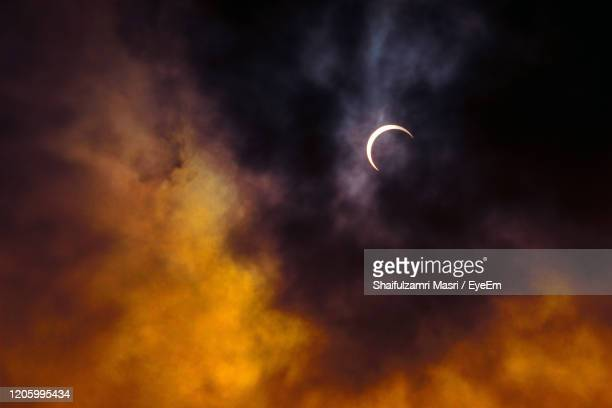 partial annular solar eclipse as  seen in malaysia in 26th dec 2019. - shaifulzamri stock pictures, royalty-free photos & images