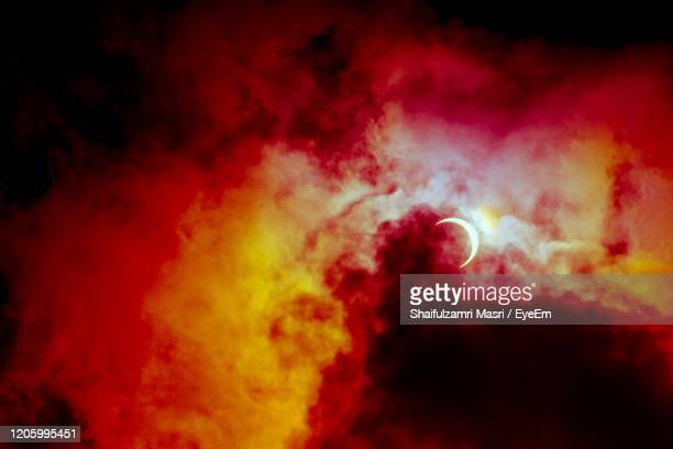 partial annular solar eclipse, known  as a ring of fire, seen in malaysia in 26th dec 2019. - shaifulzamri stock pictures, royalty-free photos & images