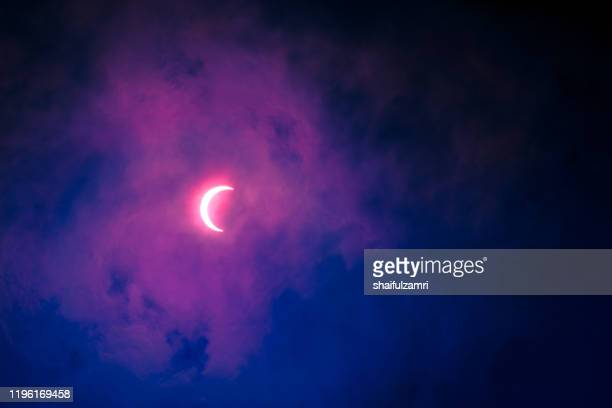 partial annular solar eclipse seen in malaysia in 26th dec 2019. - shaifulzamri stock pictures, royalty-free photos & images