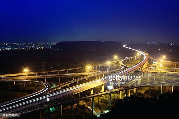 Partial cloverleaf interchange in blue hour