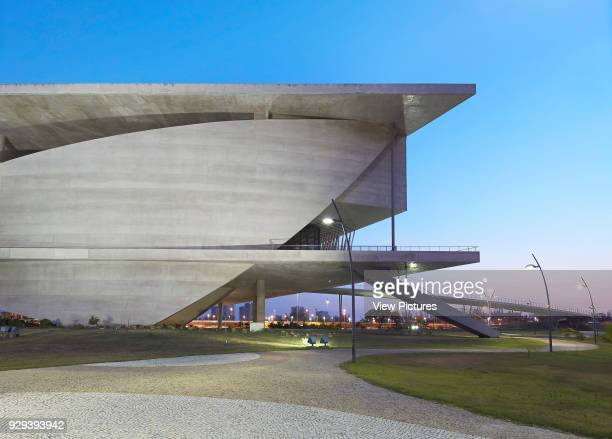 Partial facade elevation with cantilever balcony at dusk La Cidade das Artes Barra da Tijuca Brazil Architect Christian de Portzamparc 2014