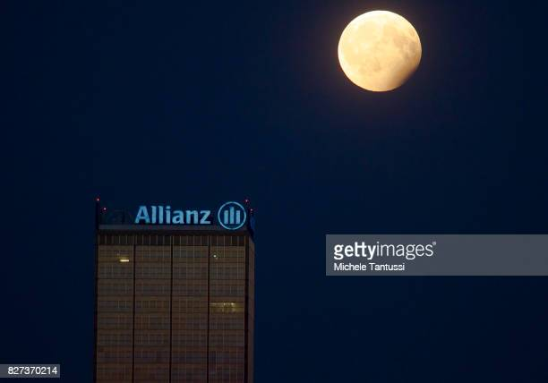 A partial lunar eclipse and the Allianz tower stand behind the Oberbaum Bridge on August 7 2017 in Berlin Germany