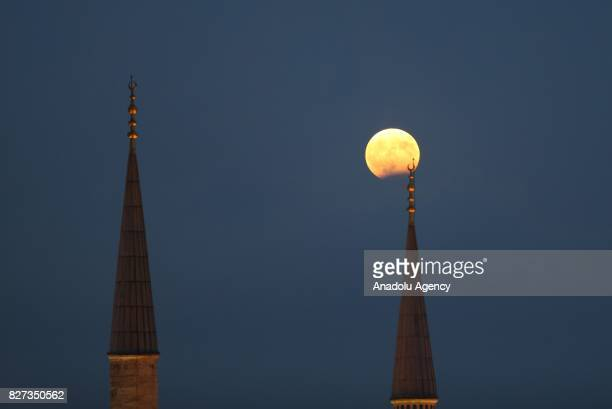 Partial Lunar Eclipse is seen between minarets in Istanbul Turkey on August 7 2017