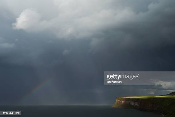 A partial rainbow forms following a heavy rain shower on August 02 2020 in Saltburn By The Sea England Heavy showers have continued through much of...