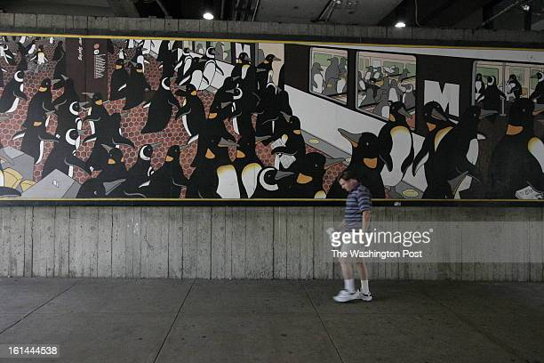 Partial removal at the Silver Spring Metro Station of the Penguin Rush Hour for restoration by the artist Sally Callmer Part of the mural under the...