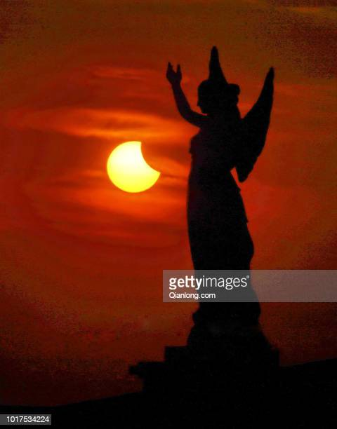 Partial solar eclipse is seen as the sun sets on August 11, 2018 in Yantai, Shandong Province of China.