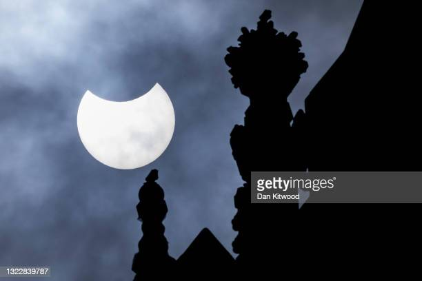 Partial solar eclipse is seen over the Houses of Parliament on June 10, 2021 in London, England. Viewers in the UK will witness a partial solar...