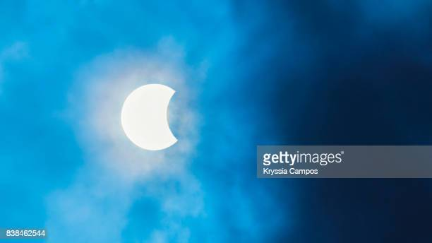 partial solar eclipse observed in costa rica, cloudy sky - part of stock pictures, royalty-free photos & images