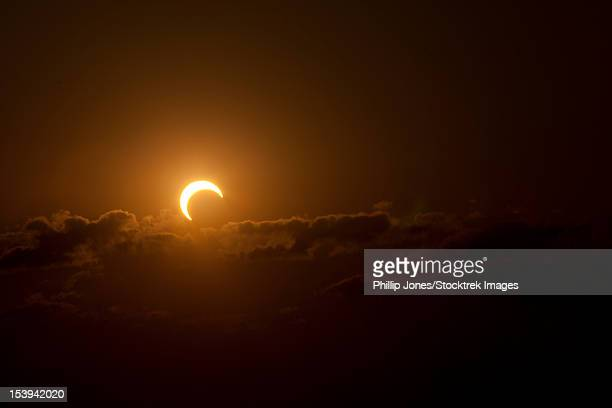 partial solar eclipse of 2012. - part of stock pictures, royalty-free photos & images