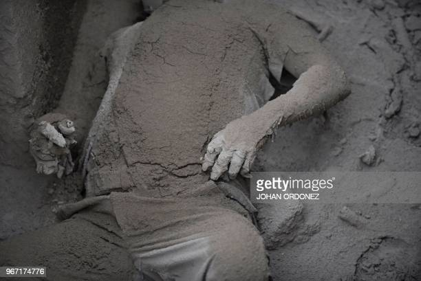 TOPSHOT Partial view of a victim of the Fuego Volcano in San Miguel Los Lotes a village in Escuintla Department about 35 km southwest of Guatemala...